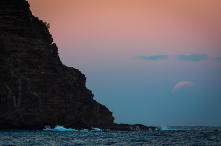 Partially eclipsed moonrise over Kawelikoa Point, Kauai